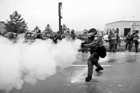 Sûreté du Québec launch tear gas toward demonstrators in Victoriaville. Photo by
