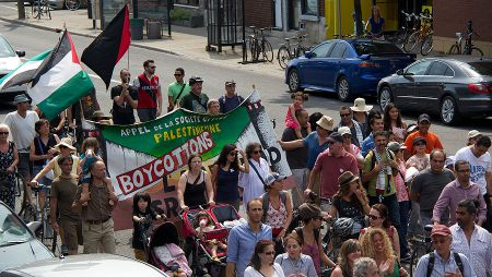 Protesters holding a banner demanding the boycott of Israel - July 19