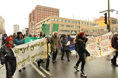 """In chilly late February, Montrealers took part in a """"slow march"""" to denounce the increase in wait times for complaints filed with Quebec's rental board. PHOTO: Project Genesis."""