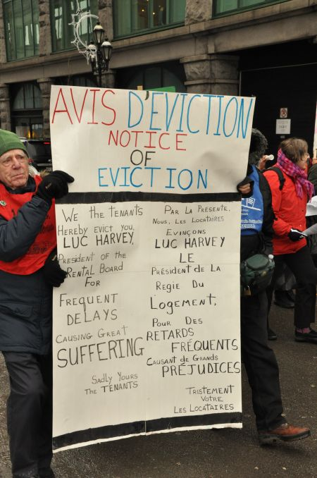 "Protesters deliver an ""eviction notice"" to Quebec's rental board to highlight the drastic rise in waiting times for tenants' complaints filed with the organization. PHOTO: Project Genesis."