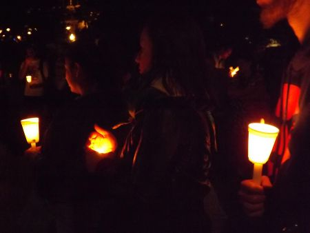 Protesters holding candles in the memory of the Palestinian victims  - July 25 Night Vigil