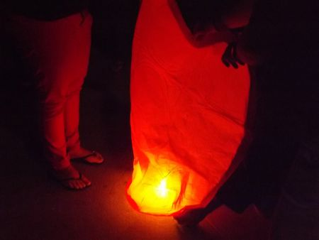 Protesters preparing a sky lantern to be released in the memory of the Palestinian victims   - July 25 Night Vigil