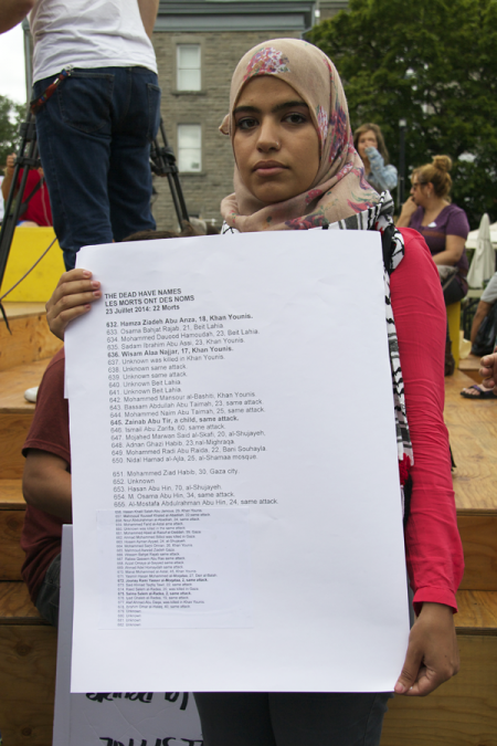 Protester holding a list of some of the names of the Palestinians killed in this latest Israeli assault on Gaza  - July 23