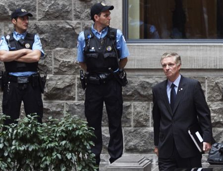 Paul Desmarais Jr., leaving a shareholders meeting of Power Corporation during student protests, May 15, 2012