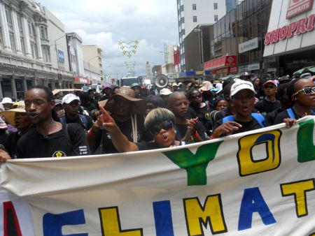 Over 10,000 people took to the street to call on governments to do more to reach a deal to curb global warming.