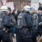 Tension mounts as protesters and police face-off during Montreal's 18th annual Protest against Police Brutality.