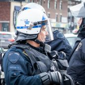Police from Blainville were observing Montreal Riot Police during Montreal's 18th annual Protest against Police Brutality.