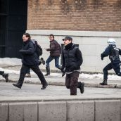 Montreal Riot Police chase protesters during Montreal's 18th annual Protest against Police Brutality.