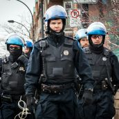 Light Armored Riot Police move in to surround the gathering at Montreal's 18th annual Protest against Police Brutality.
