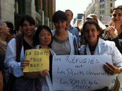 Members of Physicians for Human Rights at the Montreal protest against health care cuts for refugees. Via Speak Up for Refugees: https://www.facebook.com/SpeakUpForRefugees