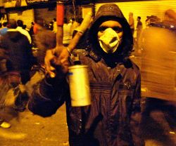 Tahrir Square protester with tear gas cannister shot by security forces and military police. Photo Credit: Ahmed Ghappour