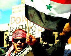 Syrian-Montrealers demonstrate in the city's streets in opposition to the Assad regime. Photo: Freedomania (via Flickr)