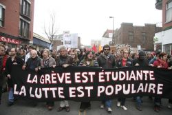 Students and supporters march through downtown Montreal. These marches may be fewer and far between once a new emergency law in adopted. Image via La Riposte on Flickr.