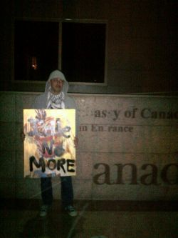 Aحmad H. عggour @Psypherize with #IdleNoMore poster in front of the Canadian Embassy in Cairo, Egypt