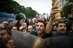A demonstration is held against the country's new government in Tunis on January 18, 2011.