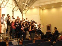 Eleanor Stubley directing the Yellow Door Choir