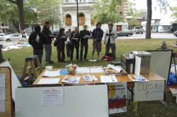Occupy Montreal's choir, la Chorale du Peuple, performs one of their activist-minded adapatations of popular songs (Sophie Blais)