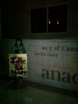 Patricia Stein @PygmySioux with #IdleNoMore poster in front of the Canadian Embassy in Cairo, Egypt