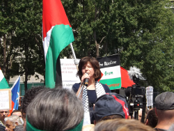 Nora Taji addressing the crowd during the August 10th Palestine-Solidarity protest