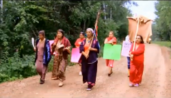 "from the video ""The March Into Poignan"" capturing the Women Elders signal to protect the land"